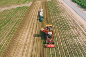 Equipment in Field – Tasteful Selections February Growing Image